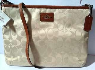 Coach Signature Nylon Ipad Crossbody Bag (Biscuit)