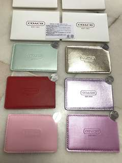 Coach stainless steel mirror