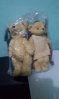 Family teddy bears in wooden rocking chair