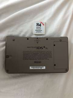 Nintendo DSi XL( brown ) Condition: 9/10. R4 With many games included. No box but its original charger will come with it.