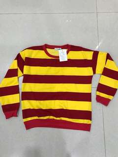 Striped red and yellow sweater