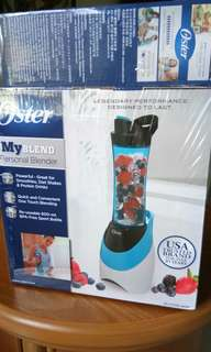 Oster Blender with free container.