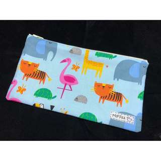 Handmade pouch - Zoo Animals with light blue background.