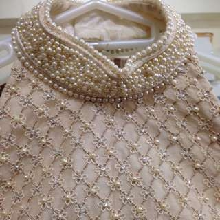 Nude pearl embellished bodice with Raw silk gown