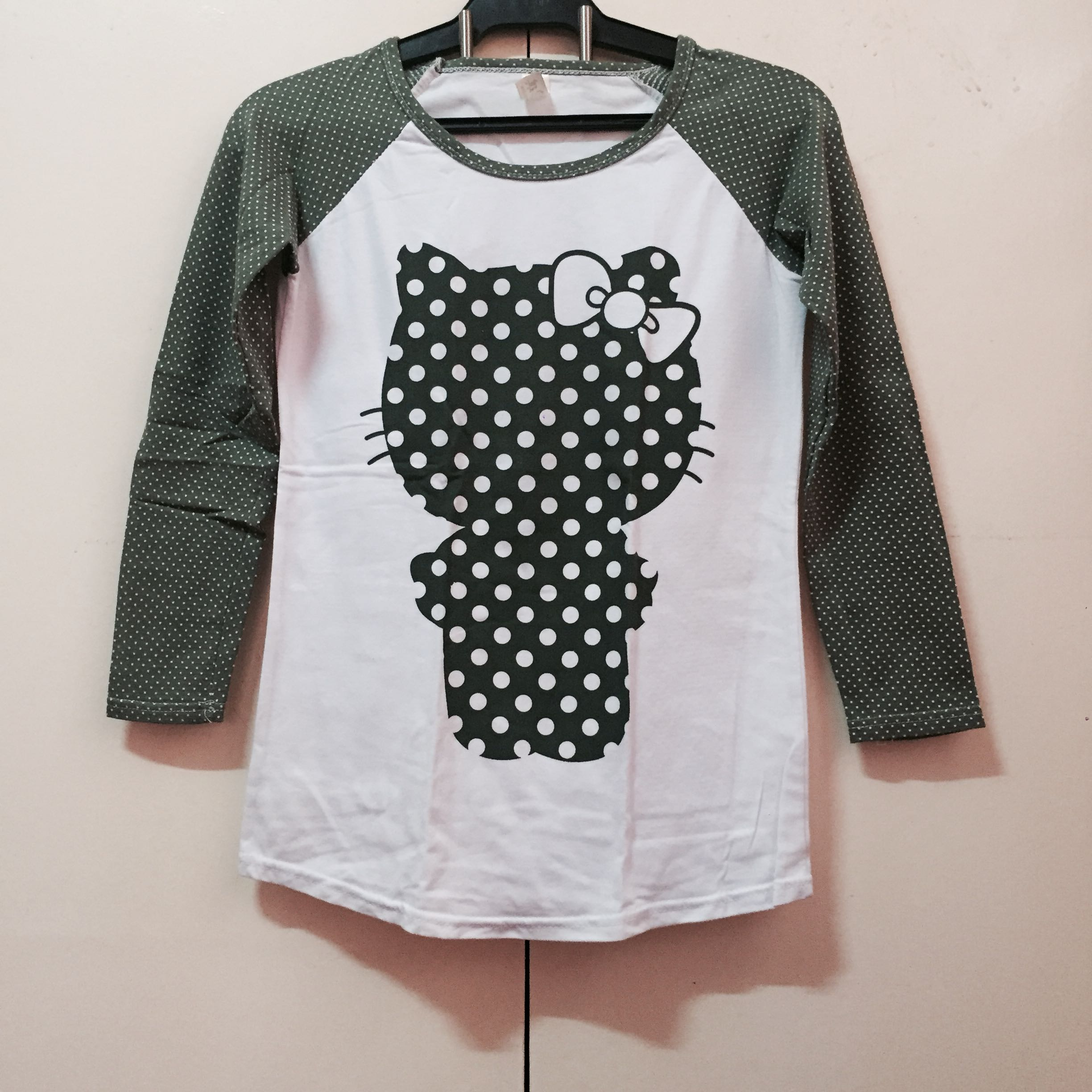 b2ca8ccf9 Green hello kitty top, Women's Fashion, Clothes, Tops on Carousell