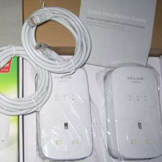 TP-Link TL-PA8030P AV1200 Homeplug . 3 Gigabit ports . with AC Passthrough