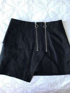 Black asymmetrical mini skirt