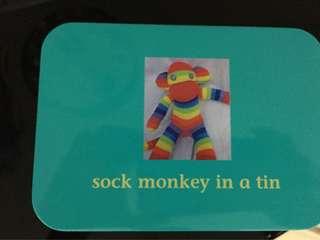 Sock in a tin