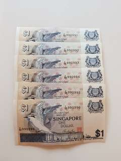Old $1 note in running numbers