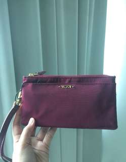 Authentic Tumi Wristlet with tag