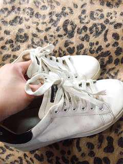 White Adidas superstar inspired shoes