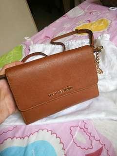 AUTHENTIC MK sling or wallet bag