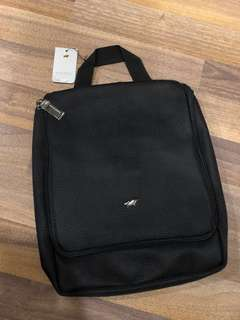 Brand new original Braun Buffel single zipper black golf toiletry bag with multiple compartments and metal hanger hook.
