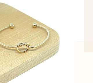 'Allegra' Love Knot Faux Gold Chic Bangle
