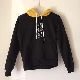 Yellow hood with Japanese words - cropped