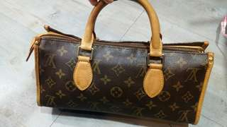 Small long LV hand bag.90percent good condition with code