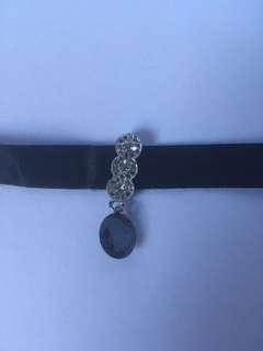 Black choker with gem