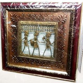 Wall frame painting with brass work figurine inside