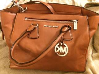 MK  authentic leather bag.. used but still in Avery good condition .. just a small color spot as shown in the pic, asking 100$ OBO.. open for trade!