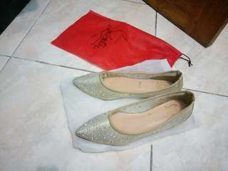 Christian Louboution flat shoes