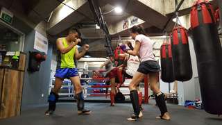Professional muay thai and conditioning class at gym