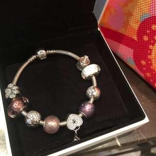 Pandora bracelet with 9 charms