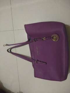Authentic MK pre owned and still negotiable.