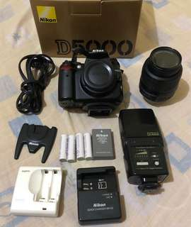 Nikon D5000 Camera + Nikkor 18-55mm lens kit + Speedlite Di466 Flash + Sanyo Quick Carger with 4 Enelope Batteries