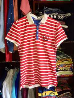 Folded and Hung White and Red Striped Polo