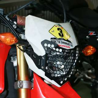 Honda CRF250L SRC Headlight Grill (Available in Black or Silver)