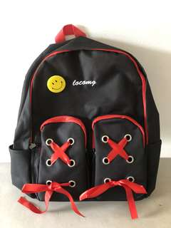 Red ribbon unique backpack