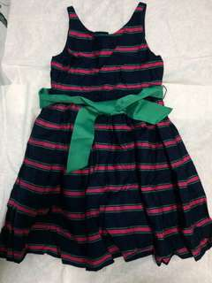 Blue dress with pink and green stripes on it