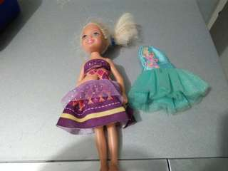 Chelsea barbie youngest sister with free clothes