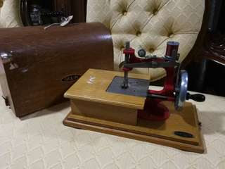 Antique mini sewing machines
