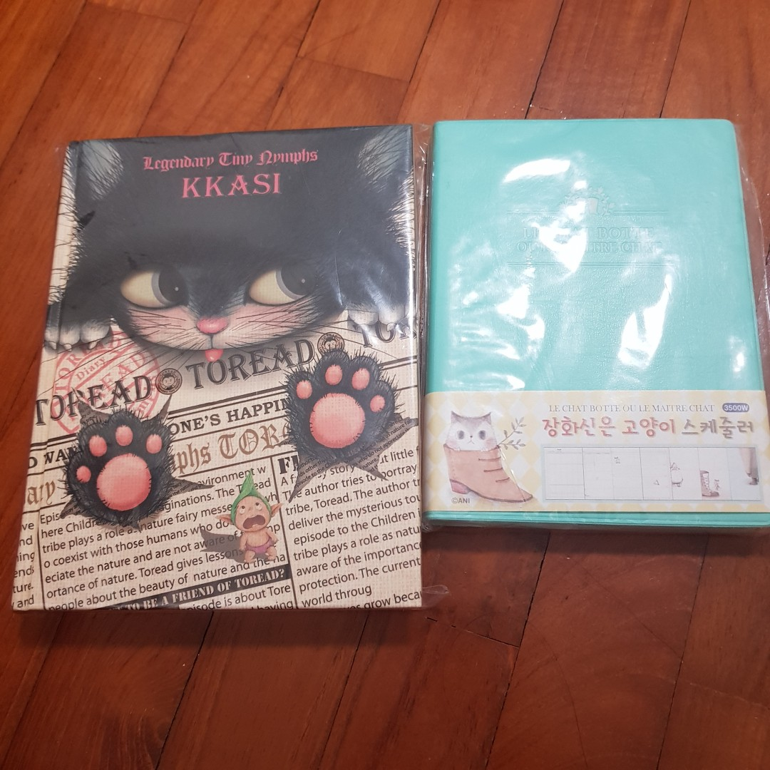 Moving Sale: Brand new cat planners