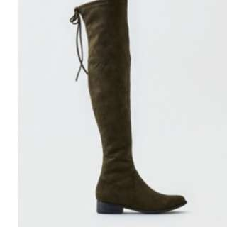 Olive skinny thigh high boots with low heels