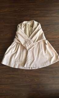 Oversized beige wool coat