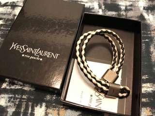 Brand new Yves Saint Laurent men's black/white woven leather bracelet