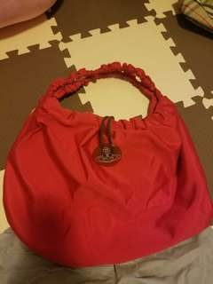 Vivienne Westwood red colour Handbag