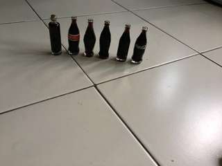 6 bottle of mini Coca Cola without caps