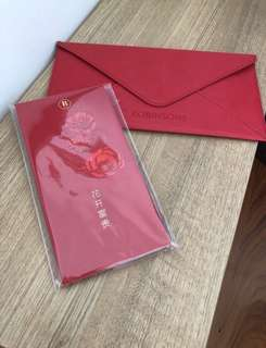 Robinson red and gold packets with holder