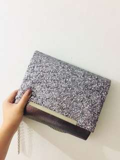 Clutch bag with sling