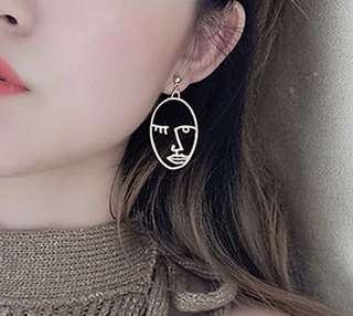 Human face dangle earrings