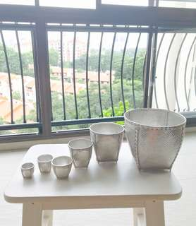 A rare set of hand woven pure silver baskets