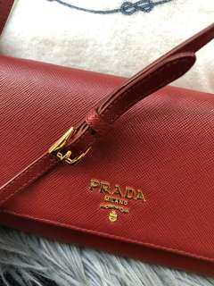 Prada red wallet with leather strap