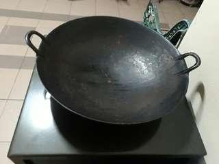 well seasoned vintage cast iron wok