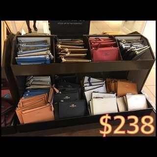 $238 coach coin case