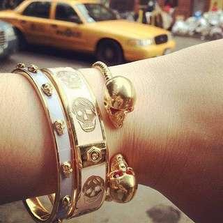 Alexander McQueen baby blue 3D skulls gold tone open bracelet skinny bangle