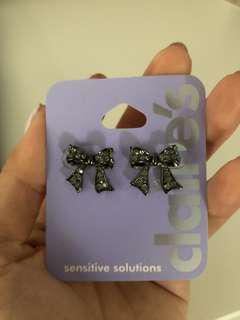 Claire's bow earrings