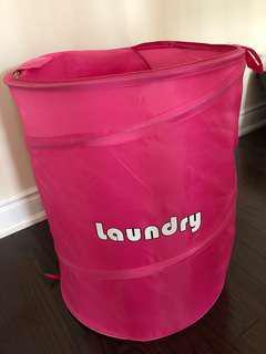 Pink laundry bin